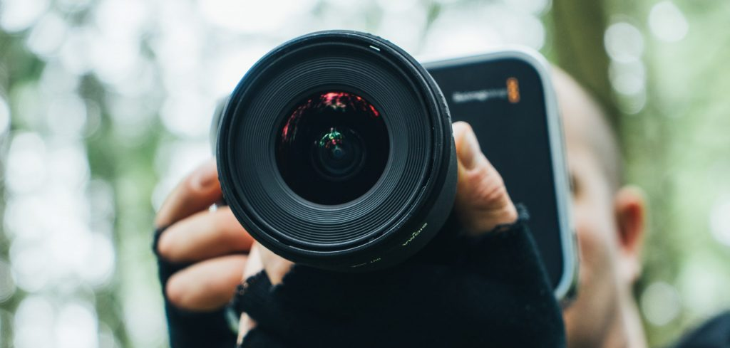 blackmagic shooting handheld crew in motion forest cameraman